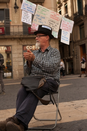 He was discussing with tourists and local people about Catalonia and Spain